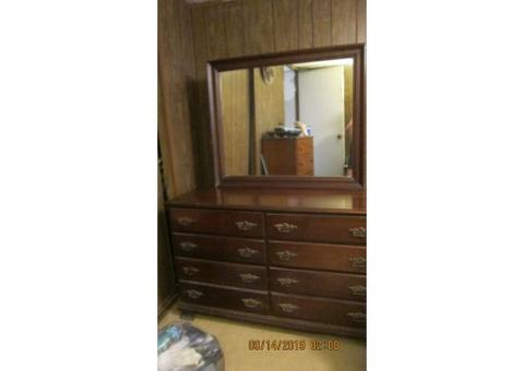 dark wood maybe mahogany  bedroom dresser with mirror