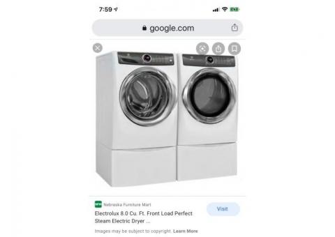 Washer and steam dryer with pedestals